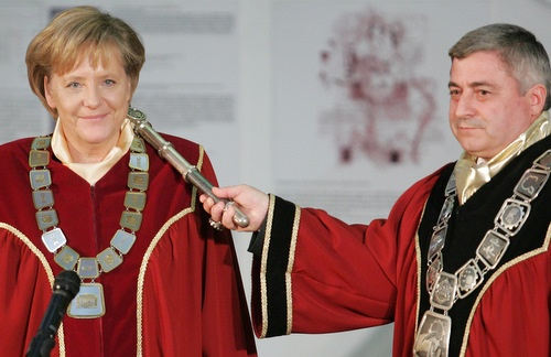 German Chancellor Merkels smiles as she receives the doctor honoris causa title from Ruse University President Hristo Beloev (right). Photo by BGNES